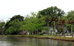 Calm neighborhood on the shore in rainy day. royalty free stock images