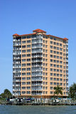 Florida coast high rise. Fancy building on the waterfront in south west florida against a deep blue sky Royalty Free Stock Photography