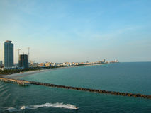 Florida Coast Jetti. A picture of the coast in Florida, USA. A long narrow breakwater is in the foreground stock photography