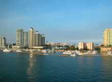 Florida Development. Tall buildings along water of Florida coastline; sky is blue and some buildings are reflecting off water stock photo