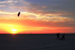 Florida Dreams. Beach florida orange red sand shadow sunset tropical wind yellow kite kids playing Stock Images