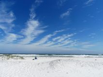 Florida Emerald Coast Beach Chair. Relaxing in a beach chair along the beautiful white sands of the Gulf Coast Royalty Free Stock Photos