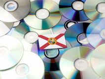 Florida flag on top of CD and DVD pile isolated on white. Florida flag on top of CD and DVD pile isolated Stock Photos