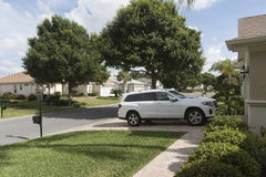 Florida housing estate and car parked on driveway. Luxury car parked on the driveway of a house in a Florida residential area, USA 2017 stock photography