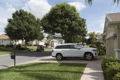 Florida housing estate and car parked on driveway. Luxury car parked on the driveway of a house in a Florida residential area, USA 2017 stock photo