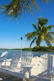Florida Keys. Beautiful Florida Keys along the shoreline with palm tree and beach lounge chairs stock image
