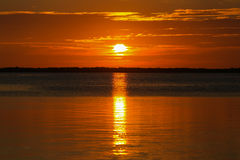 Florida Keys Sunset. Tangerine sunset in the Florida Keys shortly before the sun is sinking into the calm sea Stock Photo