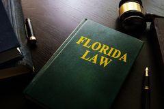 Florida law. Florida law and gavel on a table stock image