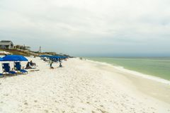 Florida Panhandle Beach. Seaside, Florida USA - March 29, 2016: Visitors enjoying the white sand beach in this popular North Florida panhandle comunity stock images