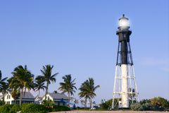 Florida Pompano Beach Lighthouse palm trees. And blue sky Royalty Free Stock Image