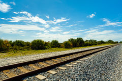 Florida railroad tracks. Long railroad track in Port Saint Lucie in Florida Royalty Free Stock Image