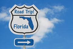 Florida Road Trip Highway Sign. Florida map and text Road Trip on a highway sign with sky background royalty free stock image