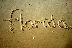 Florida in the sand. Florida written in the sand at the beach stock image