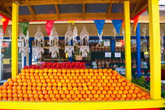Florida Souvenirs. Colorful display of Florida souvenirs including fresh oranges and produce along with seashell decorative hangars in colorful roadside booth Stock Photos