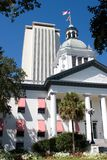 Florida State Capitol Buildings. The old Florida State Capitol building in Tallahassee sits in front of the new modern capital building which can be seen rising Stock Image