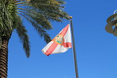 Florida state flag. High on flag pole against clear blue south Florida skies Stock Photo