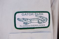 Florida state  gator park everglades staff badge. There is logo or badge on the shirt of the service staff in Everglades , Florida , USA . The main point  is Stock Image