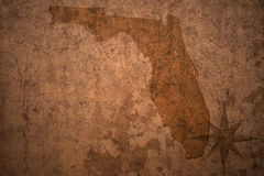 Florida state map on a old vintage paper background. Florida state map on a old vintage crack paper background stock images