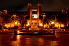 Westcott Building at Florida State University. Florida State University Plaque with fountain in front of the Westcott Building, lit up at night stock photography