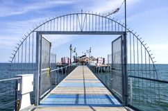 Florida style sea bar. The bridge and the entrance to the Pagoda, a Florida style sea bar which can be found on the Adriatic sea of Lignano Sabbiadoro, Italy Royalty Free Stock Image