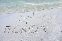 Florida and sun drawn in sand beach vacation Stock Photography