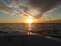 Florida Sunset from Boat Bow. Beautiful sunset from Lovers' Key beach in Fort Myers, Florida, US Royalty Free Stock Photos