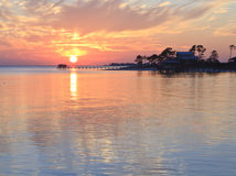 Florida Sunset Silhouette. Sun setting behind a boat pier in Gulf Breeze, Florida royalty free stock photos