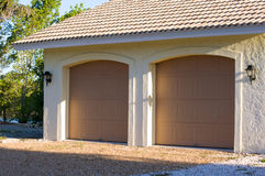 Florida two car garage. View of exterior of  modern two car garage with doors closed in florida Royalty Free Stock Photography