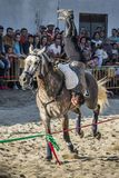 Florin Harabor showing a figure of Cossack Vaulting in a horse fair in Lugo, Spain, August 2016. Florin Harabor in action doing a figure of Cossack Vaulting in royalty free stock photo