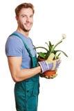 Florist с заводом paintbrush стоковое изображение