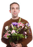 Florist. A male florist holding a bouquet of flowers, isolated against a white background Royalty Free Stock Photography