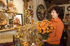 Florist. Seller of flowers with bunch of flowers stock photo