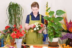 Florist. Young florist working on flower bouquet stock photo