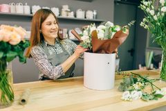 Florist accepts payment from female customer Royalty Free Stock Photos