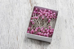 Florist accesories. Box of sewing pins Stock Images