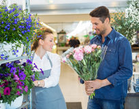 Florist Assisting Customer In Buying Flower Bouquet Stock Images
