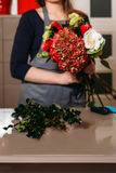 Florist with beautiful bouquet of flowers Stock Photo