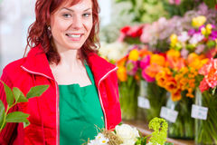 Florist binding flower bunch in shop Royalty Free Stock Photography