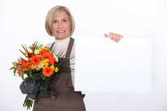 Florist with a bouquet Stock Image