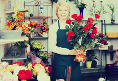 Florist with a bouquet of red roses Royalty Free Stock Image
