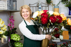 Florist with a bouquet of red roses Royalty Free Stock Photography