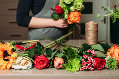 Florist with bouquet of roses at work. Stock Images