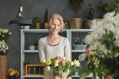 Florist and bouquet of tulips Stock Photos