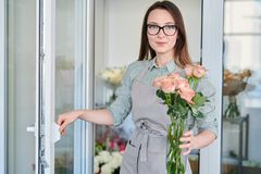 Florist with bunch of roses royalty free stock photo