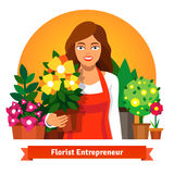 Florist business owner holding a pot of flowers Royalty Free Stock Images