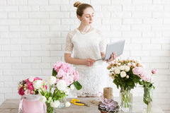Florist check her order list before work royalty free stock image