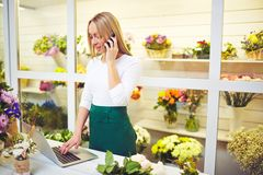 Florist consulting buyers Stock Photo