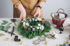 Florist decorator making Christmas wreath Royalty Free Stock Photography