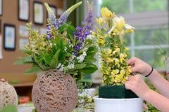 Florist designing gestures Stock Photography