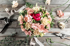 The florist desktop with working tools on gray old wooden background Royalty Free Stock Photos